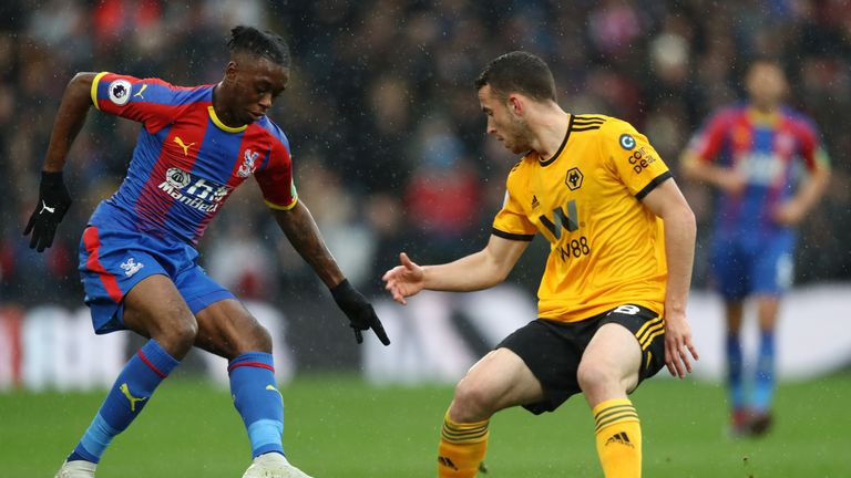 Aaron Wan-Bissaka is challenged by Diogo Jota