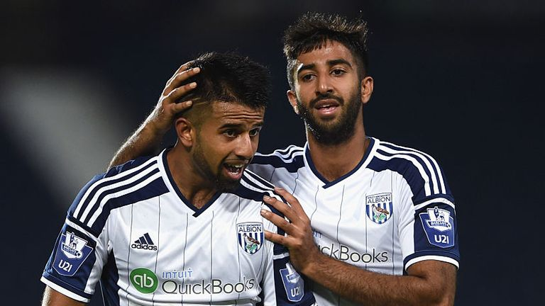 Nabi celebrates a goal with brother Samir during a West Brom U21 game