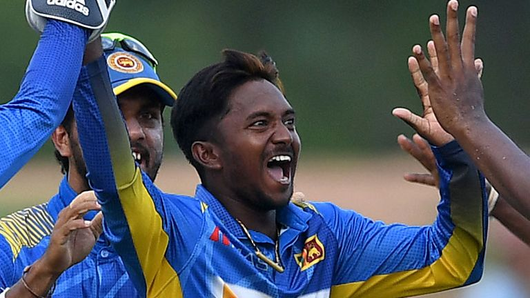 Sri Lanka spinner Akila Danajaya celebrates the wicket of Jason Roy in the first ODI, in Dambulla