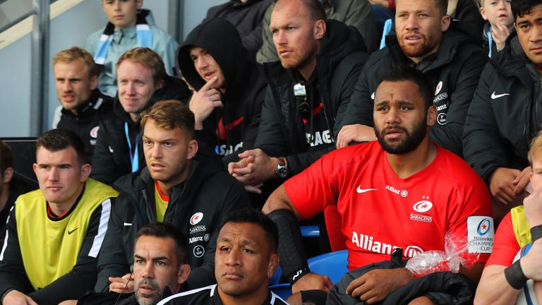 Billy and Mako Vunipola look on after both leaving the field with injuries during the match
