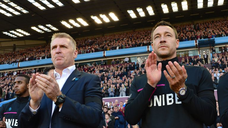 Aston Villa head coach Dean Smith and assistant John Terry during the minute's applause for the late Sir Doug Ellis at Villa Park