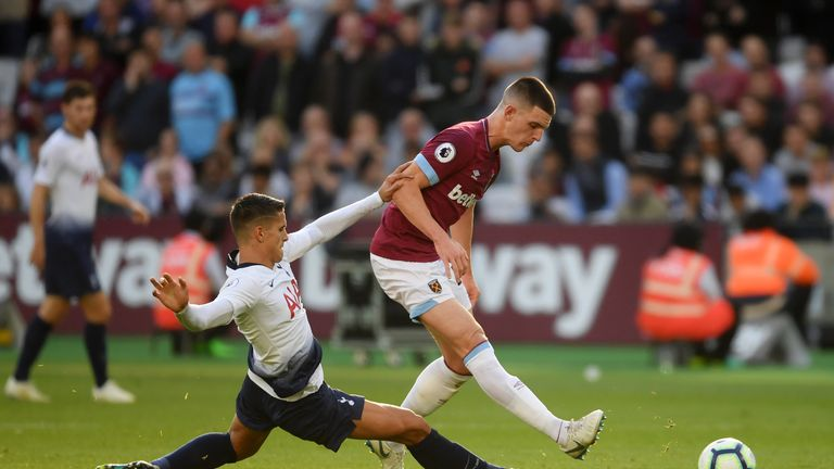 Declan Rice (right) plays the ball under pressure from Tottenham's Erik Lamela
