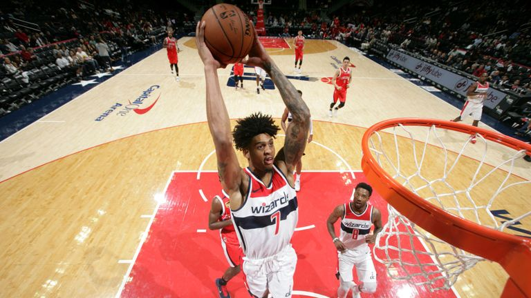 Devin Robinson #7 of the Washington Wizards goes up for the dunk against the Guangzhou Long-Lions on October 12, 2018 at Capital One Arena in Washington,