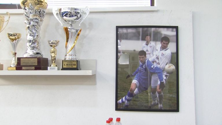 Photographs of a young Dzeko in the media room of the Grbavica Stadium