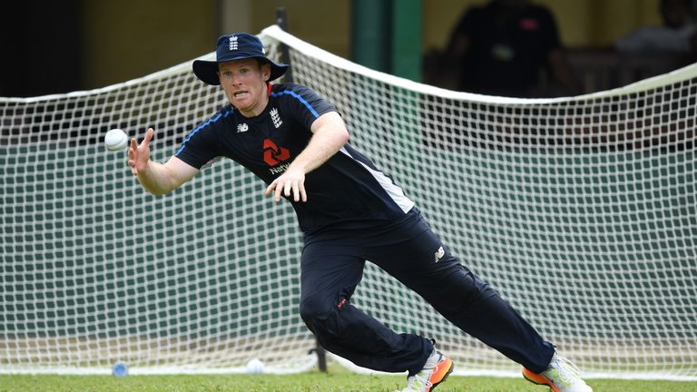 England captain Eoin Morgan dives for a catch during fielding practice in Sri Lanka