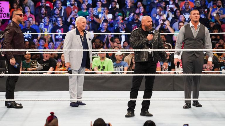 Legendary faction Evolution were back for SmackDown 1000 - but there was tension between Batista and Triple H