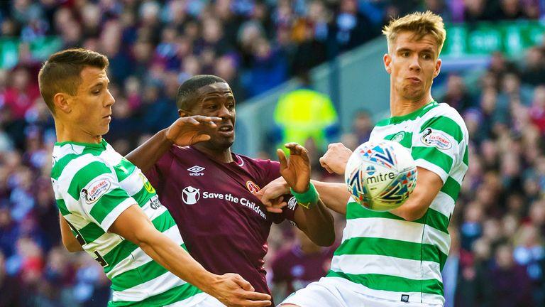 Hearts' Arnaud Djoum battles with Celtic's Filip Benkovic and Kristoffer Ajer