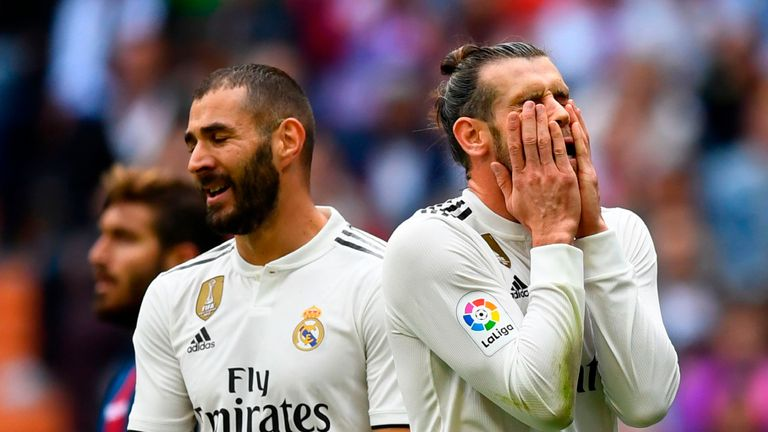 Gareth Bale and Karim Benzema react during Real Madrid's loss to Levante