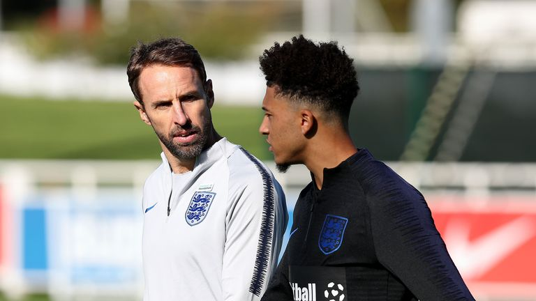 Jadon Sancho pictured with Gareth Southgate at St George's Park