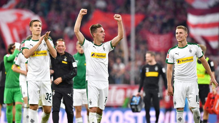 The Gladbach players celebrate at the full-time whistle at the Allianz Arena