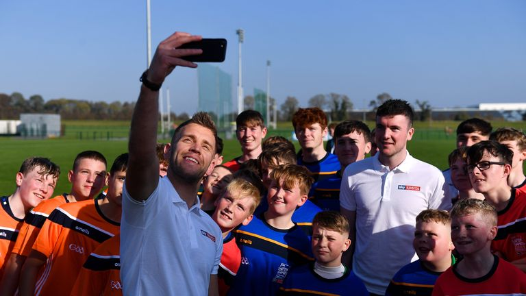 Dublin footballer Jonny Cooper and Limerick hurler Declan Hannon with participants at the GAA Super Games Centre National Blitz Day in partnership with Sky Sports at the GAA Games Development Centre in Abbotstown, Dublin.