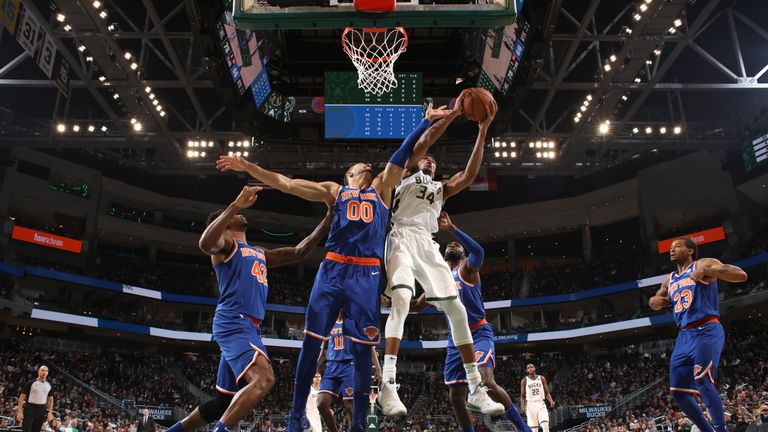 Giannis Antetokounmpo #34 of the Milwaukee Bucks rebounds the ball against the New York Knicks on October 22, 2018 at Fiserv Forum in Milwaukee, Wisconsin