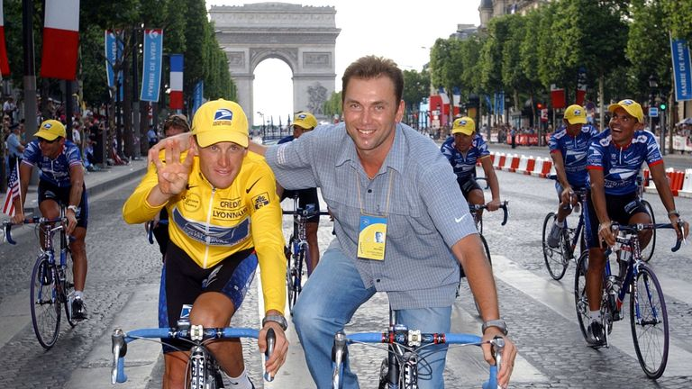 Lance Armstrong's former  manager Johan Bruyneel (R) has been banned from cycling for life