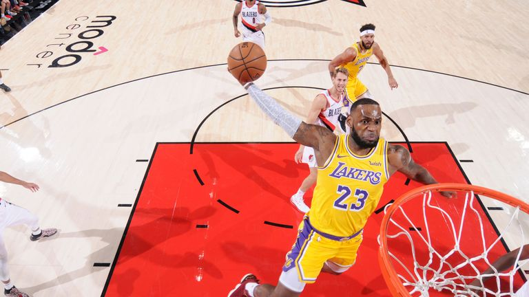 LeBron James #23 of the Los Angeles Lakers dunks the ball against the Portland Trail Blazers on October 18, 2018 at the Moda Center in Portland, Oregon.