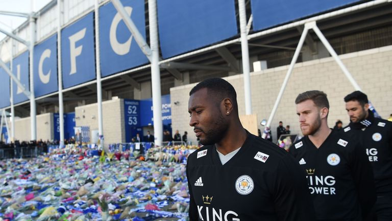 Leicester City captain Wes Morgan arrives to pay his respects