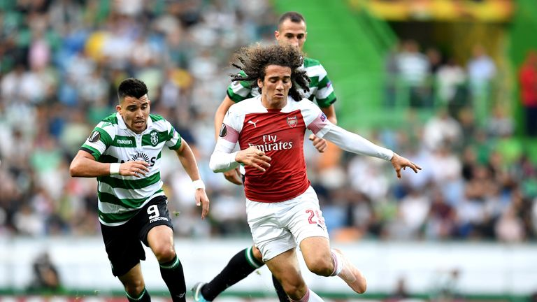 Marcos Acuna and Matteo Guendouzi chase the ball in the first half