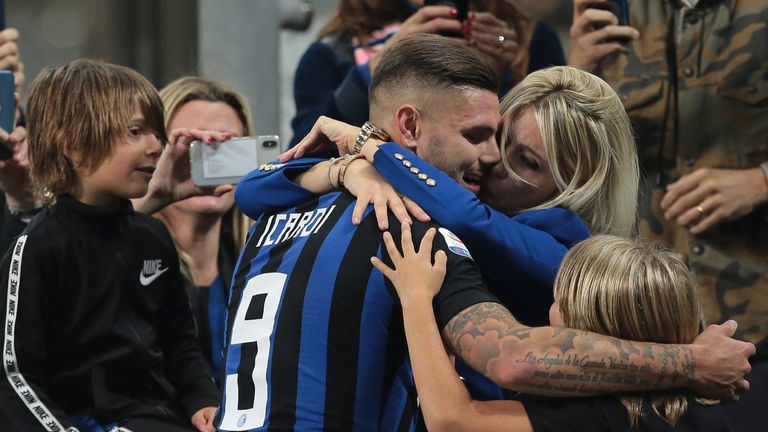 Mauro Icardi embraces his wife Wanda Nara after the late victory