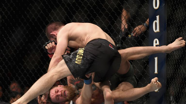 Khabib Nurmagomedov gets Conor McGregor in a choke hold to end the fight