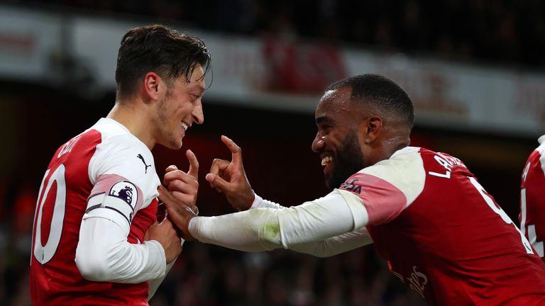 Mesut Ozil celebrates after stroking home Arsenal's equaliser