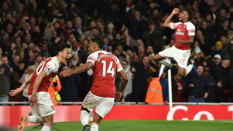 Mesut Ozil and Pierre-Emerick Aubameyang celebrate Arsenal's stunning third goal