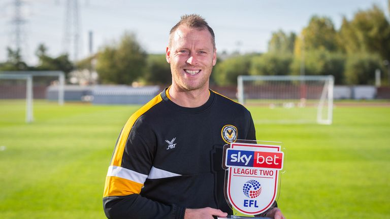 Michael Flynn with his Sky Bet League Two Manager of the Month award for September