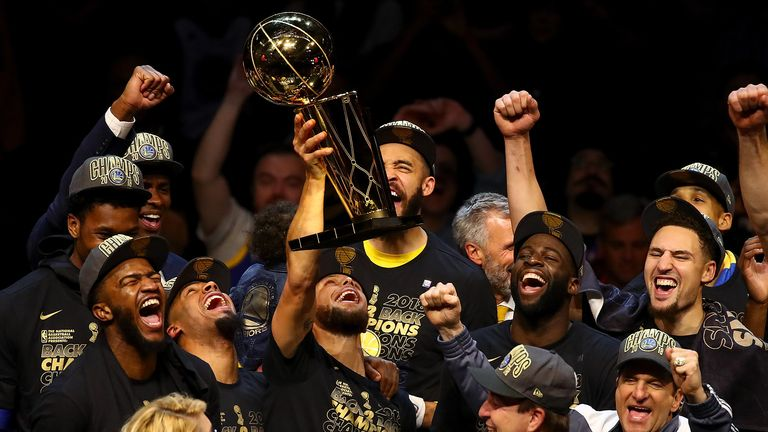 The Golden State Warriors celebrate with the Larry O'Brien Trophy after defeating the Cleveland Cavaliers in Game Four of the 2018 NBA Finals at Quicken Loans Arena on June 8, 2018 in Cleveland, Ohio