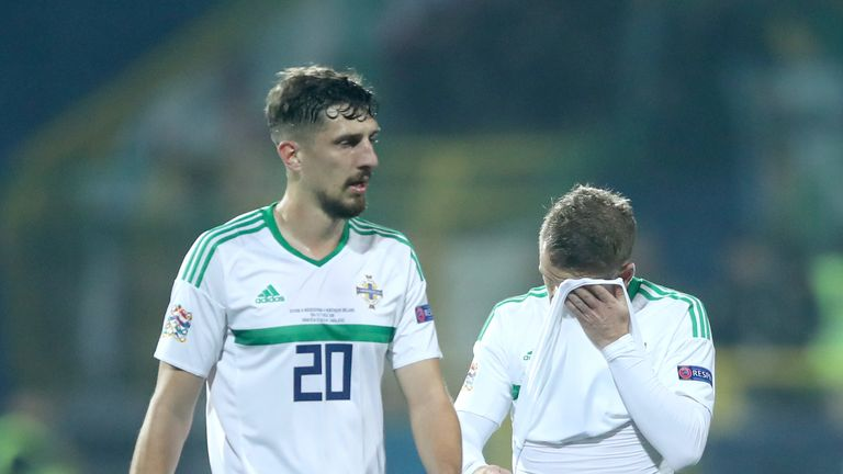 Craig Cathcart (left) and Steven Davis react to Bosnia taking the lead