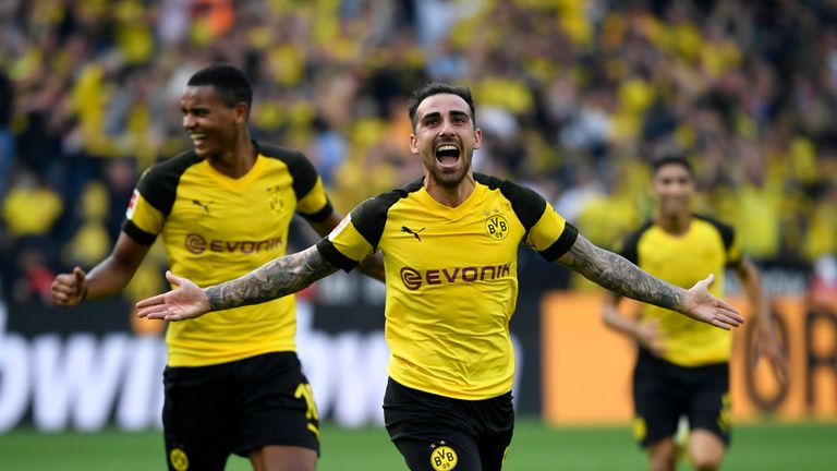 Paco Alcacer scored a hat-trick as Borussia Dortmund defeated Augsburg