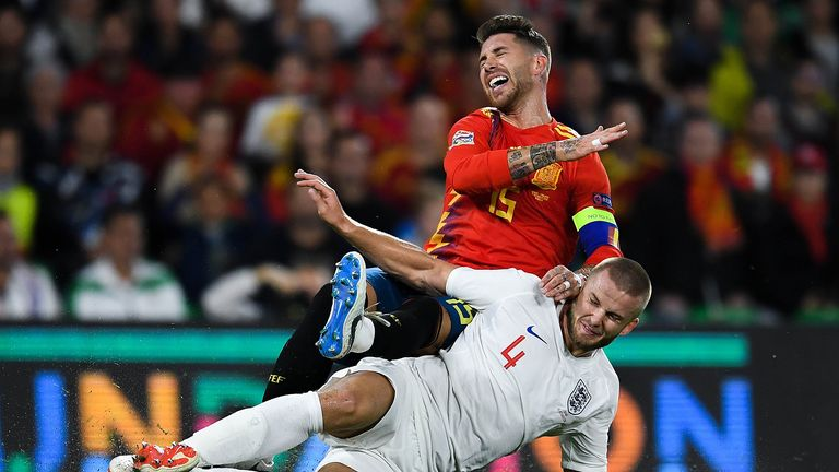 Ramos winces after feeling the full force of Dier's robust challenge