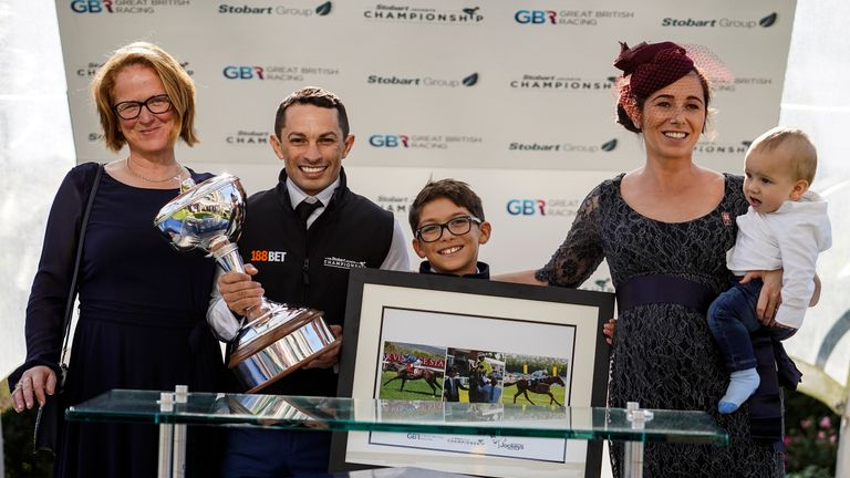 Silvestre De Sousa with his Stobart Champion Jockey Trophy at Ascot Racecourse