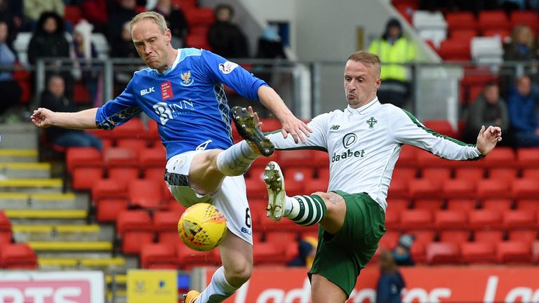 St Johnstone defender Steven Anderson (left) tries to clear the ball from Celtic striker Leigh Griffiths