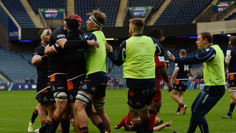 Stuart McInally is swarmed by Edinburgh team-mates after scoring against Toulon