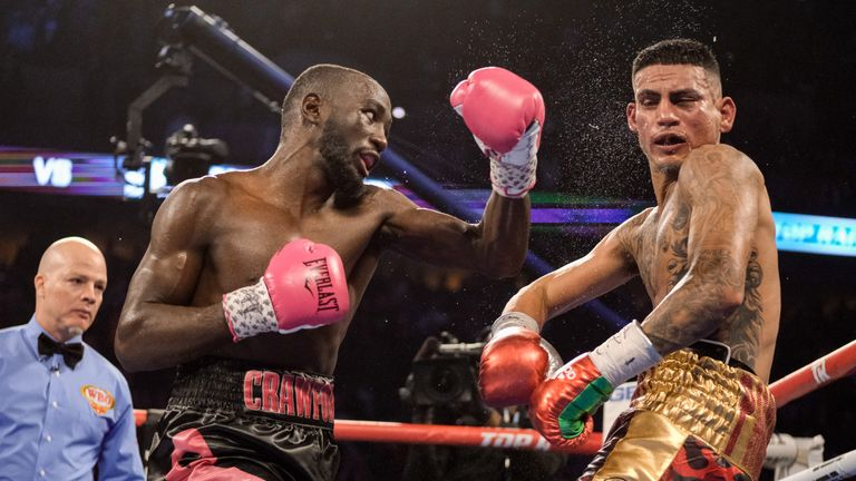 Terence Crawford (L) could face Errol Spence after stopping Jose Benavidez in Omaha