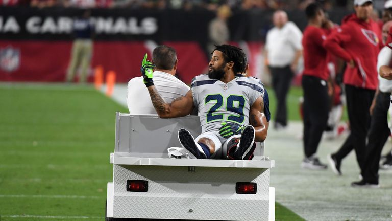 Earl Thomas gestures towards the Seattle Seahawks bench after being injured