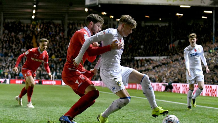 Alioski battles for the ball with Nottingham Forest's Tobias Figueiredo