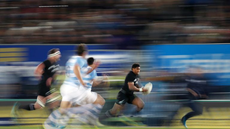 Waisake Naholo of the All Blacks makes a break against Argentina