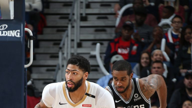 Anthony Davis dribbles away from LaMarcus Aldridge