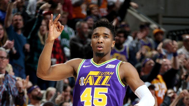 Donovan Mitchell is action for the Utah Jazz against the Dallas Mavericks