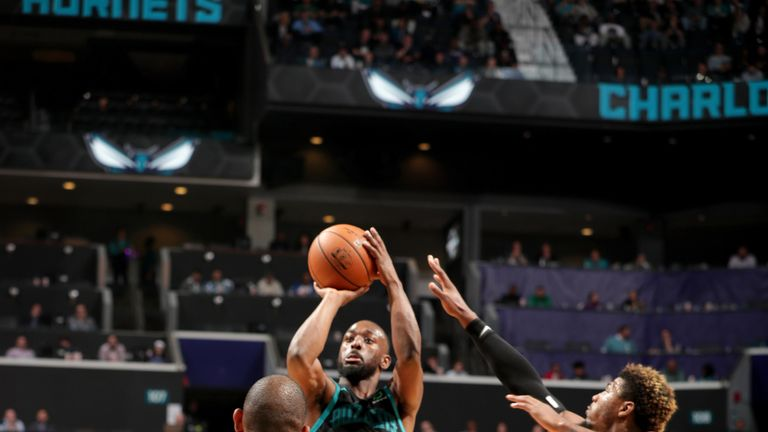 Kemba Walker launches a jumper against Boston