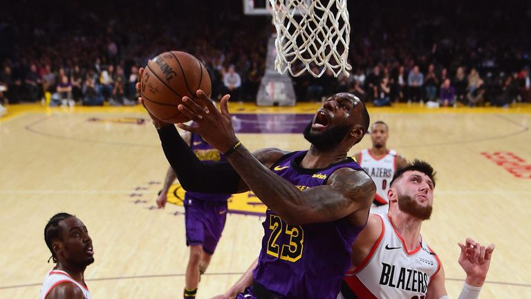 LeBron James scores with a lay-up against the Portland Trail Blazers
