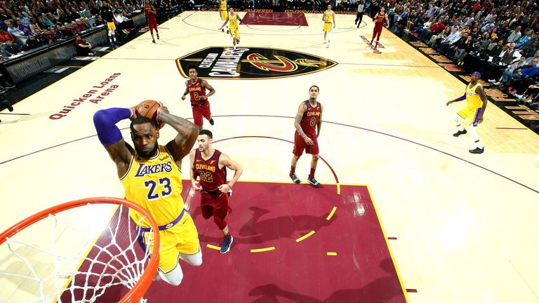 LeBron James throw down a dunk during the Lakers' comeback win over his former team the Cavaliers