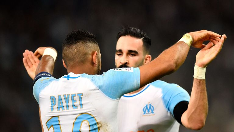 Adil Rami celebrates with Dimitri Payet