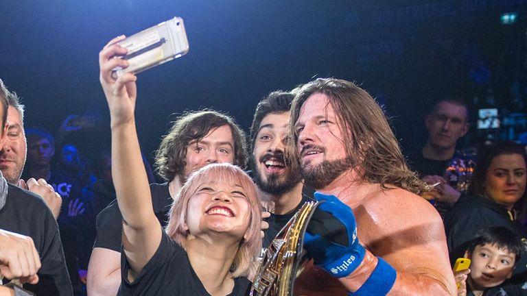 AJ Styles spent a long time after his match meeting fans
