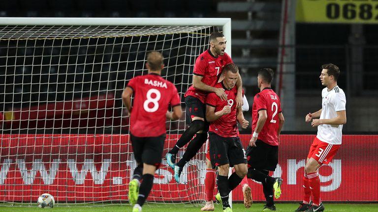 Albania's Bekim Balaj celebrates after scoring from the spot