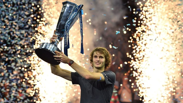 Alexander Zverev holds up the trophy after beating Serbia's Novak Djokovic in their men's singles final match on day eight of the ATP World Tour Finals tennis tournament at the O2 Arena in London on November 18, 2018.