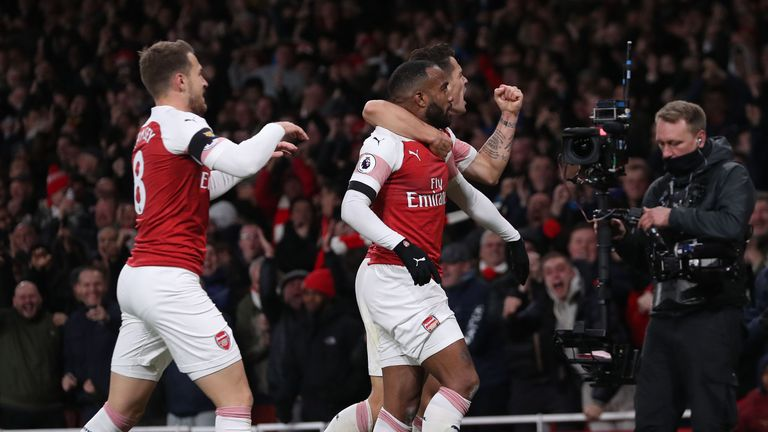 Alexandre Lacazette and Granit Xhaka celebrate the Frenchman's late equaliser