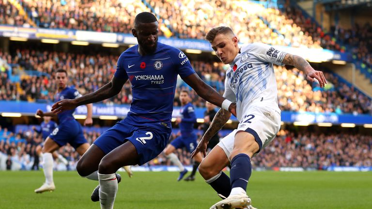 Antonio Rudiger battles for possession with Lucas Digne