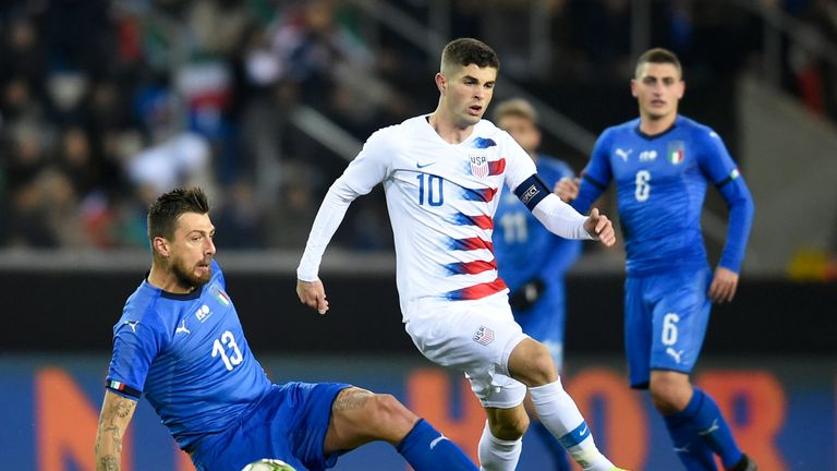 Christian Pulisic in action for USA against Italy