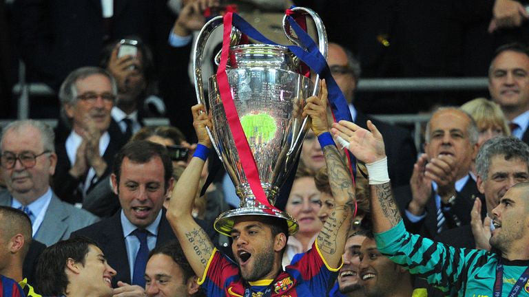 Dani Alves lifts the Champions League trophy in 2011