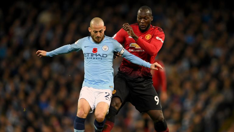Romelu Lukaku battles for the ball with Silva